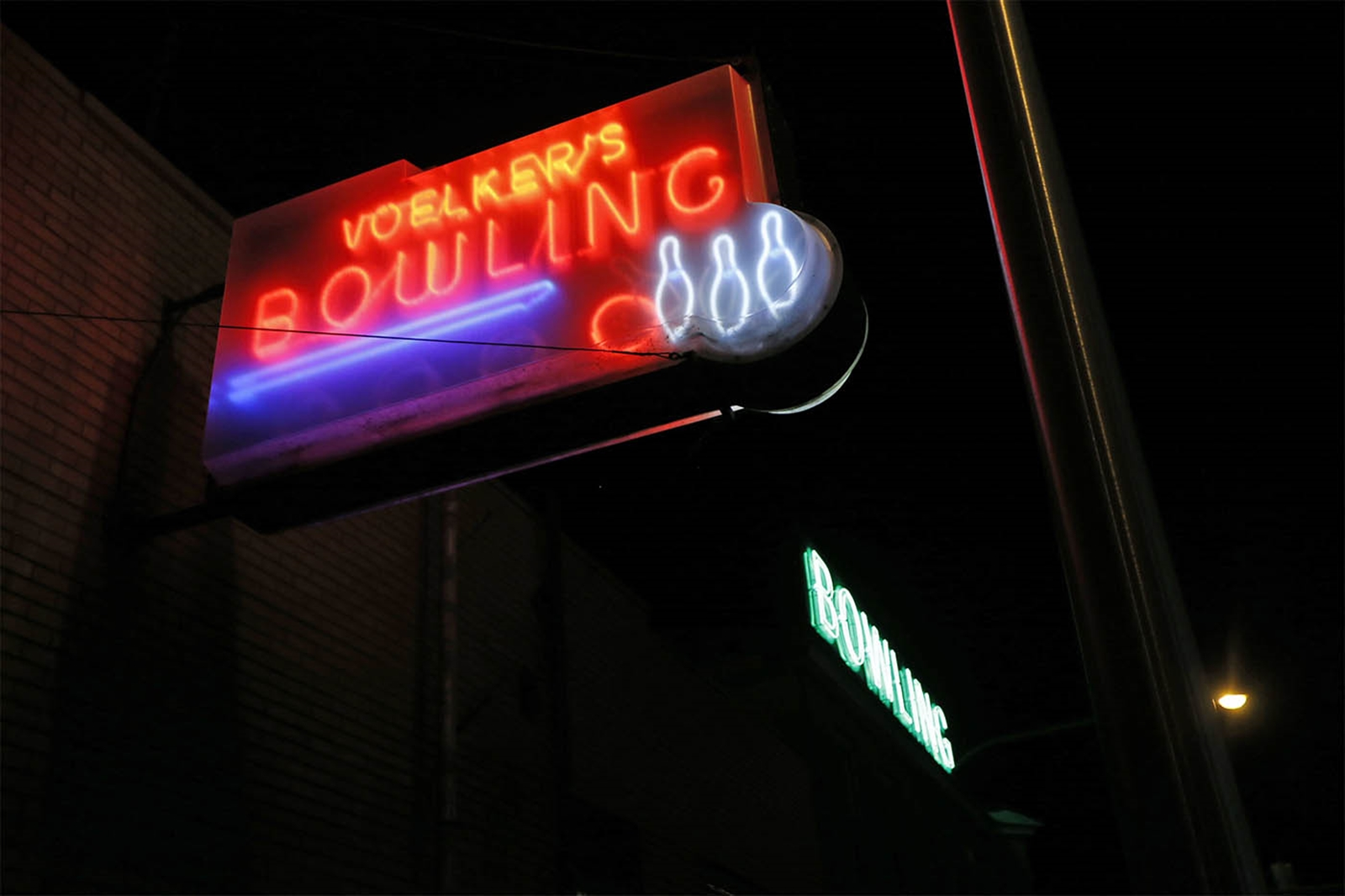 The exterior of Voelkeru2019s Lanes, which has been an entertainment hotbed in Buffalo since 1892. The Elmwood Avenue landmark is known for its colorful, flashing neon sign, vintage barroom and the sights and sounds of bowling.